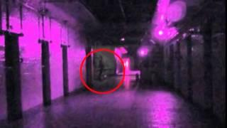 Ghost hunters capture eerie image of young girl kneeling on the floor of an asylum