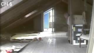 Hotel attic door opening on camera