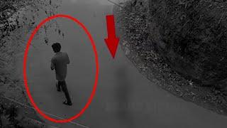 A Shadow Following A Man!!  Real Paranormal Activity Caught on CCTV Camera!!
