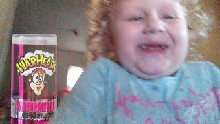 Little Girl Tries War Heads Sour Spray Candy!