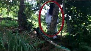 GHOST ACTIVITY CAUGHT BEHIND TREE | Real violent poltergeist on camera real ghosts Scary Videos